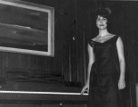Woman standing next to a piano, 1960s