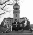 Three students sitting on Old Main Hill stairs, circa 1970