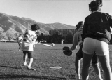 Women playing softball on the Quad, 1970s