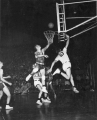 Utah State University playing Brigham Young University in a basketball game, 1950s