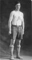 Basketball player Burns Crookston in uniform, 1913
