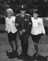 Angel Flight members Pam Gabrielsen and Sue Crisfield accompany Peter Krueger of the Air Force...