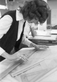 Woman in a drafting class, working at drafting table, 1960s