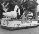 "A parade float declaring ""We're expecting victory,"" 1950s"