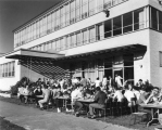 Students eating outdoors on east side of Student Union building, late 1950s