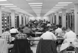 Students at study tables on second floor of Merrill Library, circa 1964