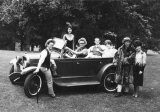 Sigma Chi Fraternity members posed in old car, circa 1960s