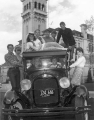 Sigma Chi Fraternity members posed on a vintage car, circa 1960s