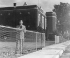 W.W. Richards standing by the northwest corner outside of the L.D.S. Institute building, 1960s