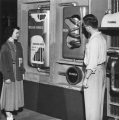 Two students looking at a display, 1952