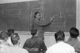 Instructor teaching a class, 1950s