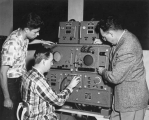 Working with an Institute of Radio Engineers' machine, 1950s