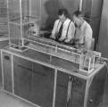 Working on exhibit, 1950s