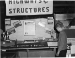 Student looking at display, 1950s