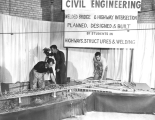 Building a model highway and bridge, 1950s
