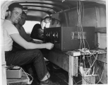Working with electric equipment inside a truck, 1950s