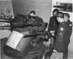 Military science class examining a machine gun mount M-55, 1950s