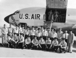 Large group of cadets posed in front of a U.S. Air Force airplane