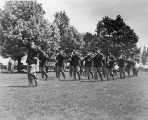 Military band marching on the Quad, 1940s