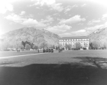 Military Inspection and Review Day, with the Merrill Library in the background, 1950s