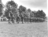 Military Inspection and Review Day, with an ROTC unit marching on the Quad, 1950s