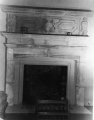 The fireplace and overmantel in the Hatch Room  located in the Merrill Library