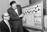 Robert P. Collier and Reed R. Durtschi looking at a chart, 1960s