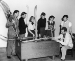 Students inspecting winter sports equipment, 1950s