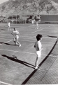 People playing tennis, 1960s