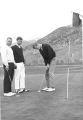 Three men golfing, 1950s