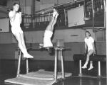 Students participating in gymnastics class, 1960s