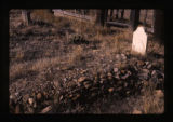 Unmarked headstone on a burial mound covered with rocks, Woodside, Utah, 1989
