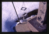Cow wind chime decoration near a grave marker, Logan, Utah, 2000