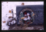 """You melt my heart"" snowman wreath on grave marker, Logan, Utah, 1999 (2 of 3)"