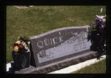 Lester W. Quick grave marker decorated with flowers in Cody, Wyoming, 1997