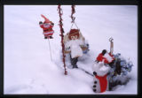 Christmas decorations on a snow covered grave marker, Logan, Utah, 1999 (2 of 2)
