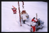 Christmas decorations on a snow covered grave marker, Logan, Utah, 1999 (1 of 2)