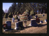 Tree with Christmas decorations in between grave markers in Salt Lake City, Utah, 2000
