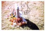Samuel Robinson heastone and grave decorations, side view, Logan, Utah, 1999