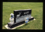 Mabe grave marker decorated with blue flowers and a white vase in Cody, Wyoming, 1997
