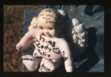 Doll with handwritten notes by a grave marker, Salt Lake City, Utah, 2000 (20 of 96)