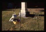 Samuel Robinson grave decorations, close-up of teddy bear and butterfly wind chimes, Logan, Utah,...