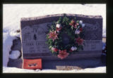 John Gottlieb and Varua Kennard Schiess grave marker decorated with a wreath in Providence, Utah,...