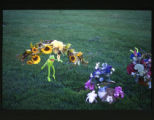 Floral arrangements and Kermit the frog grave decorations, Ephraim, Utah, 2000