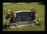 Susan L. Peterson and John R. Peterson grave marker with flowers in Cody, Wyoming, 1997
