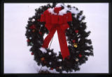 Snow-covered Christmas wreath in Logan, Utah, 1999