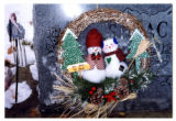 """You melt my heart"" snowman wreath on grave marker, Logan, Utah, 1999 (1 of 3)"