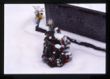 Christmas grave decorations on a grave for several people, Logan, Utah, 1999