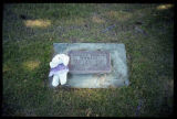 Child's grave marker decorated with a white teddy bear in Smithfield, Utah, 1999