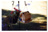 Plywood birdfeeder house at a gravemarker, Logan, Utah, 1999 (1 of 3)